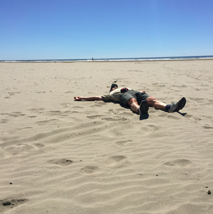 Shavasana counts in yoga, right? (This is my dad last year on the Oregon Coast)