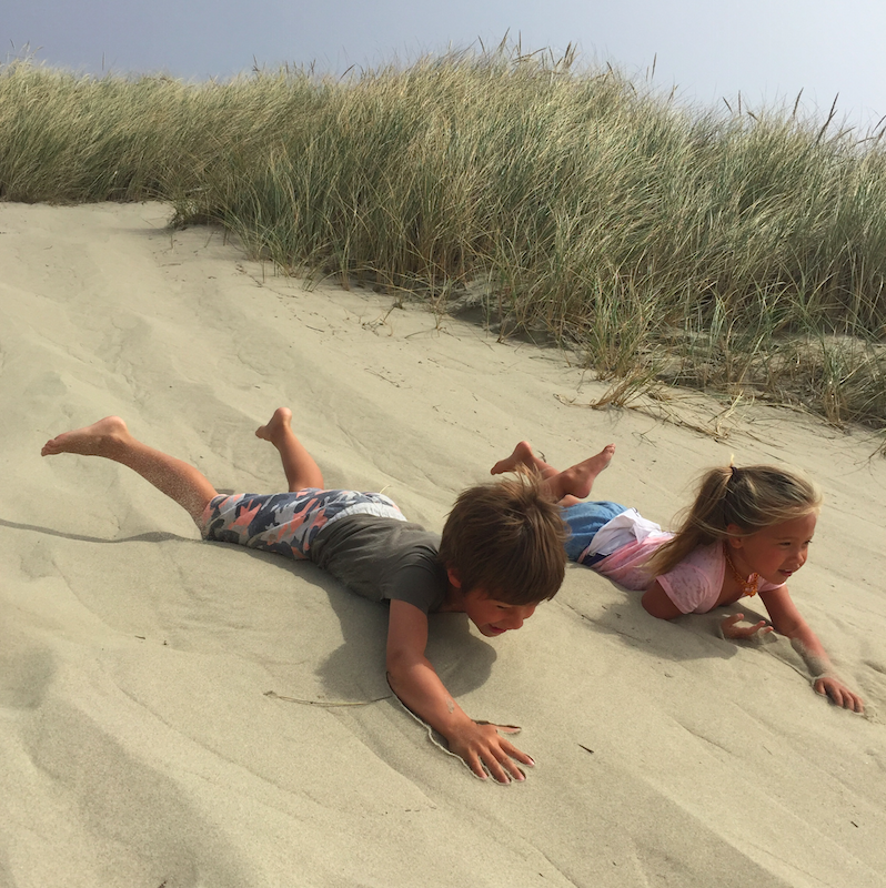 A new sport: sliding down dunes.