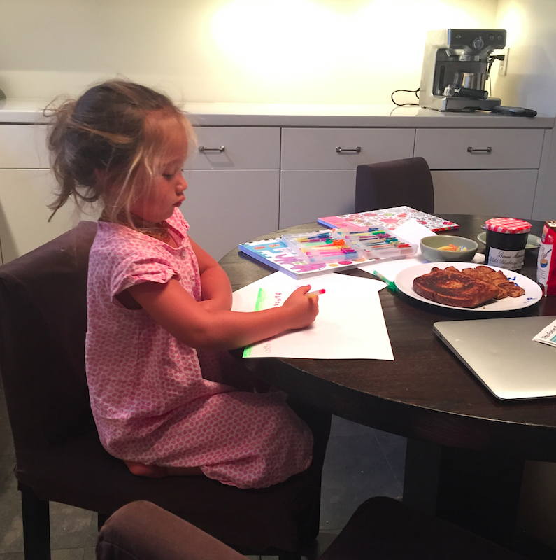 Our typical breakfast routine....eating while coloring.