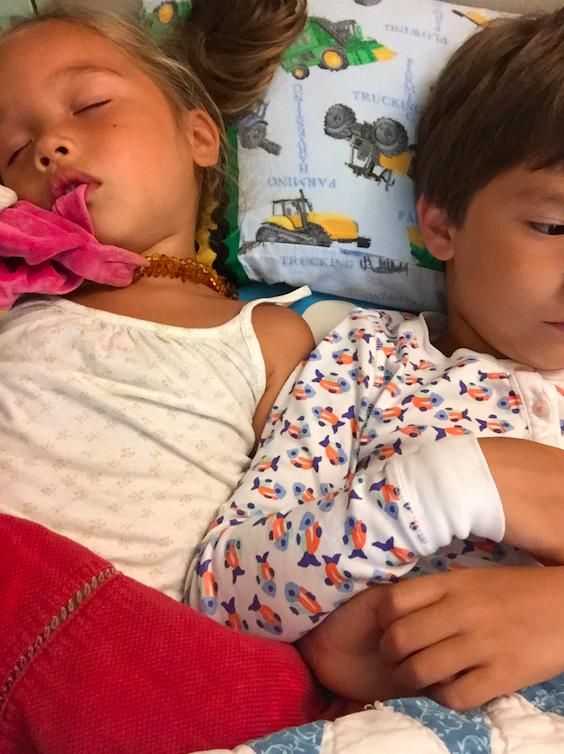 Sleeping kids and Cruzzie is sporting a fish print RRR pajama set.