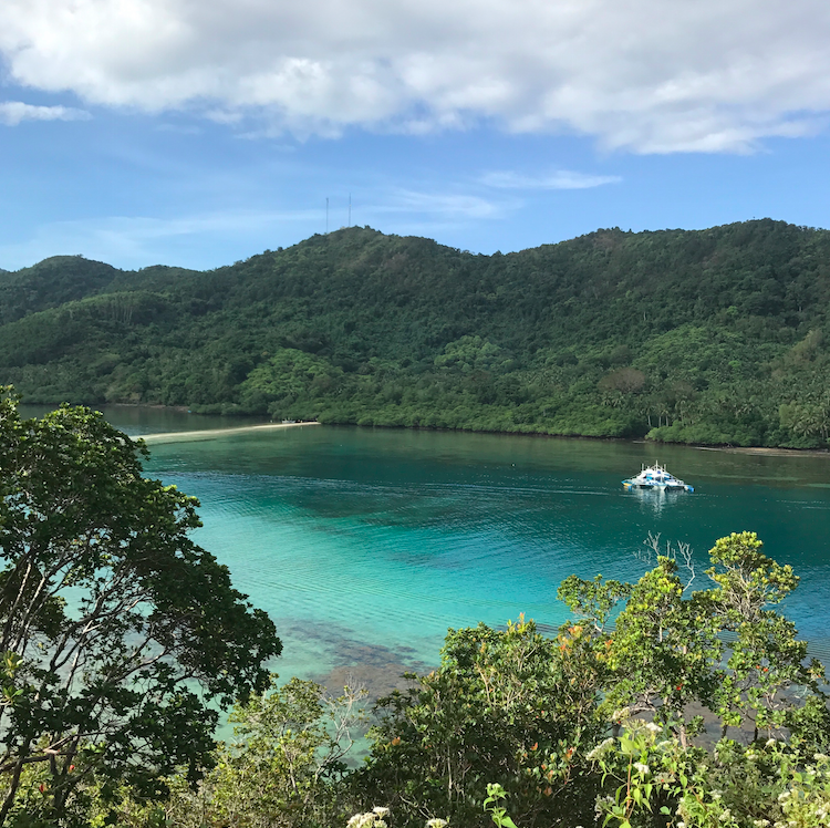 The view from the hike where you can see the sand bar I walked across and the boat that we used to take us exploring.