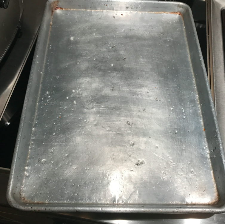 Grease the cookie sheet with coconut oil (or simply use a spray). I opted for the oil.