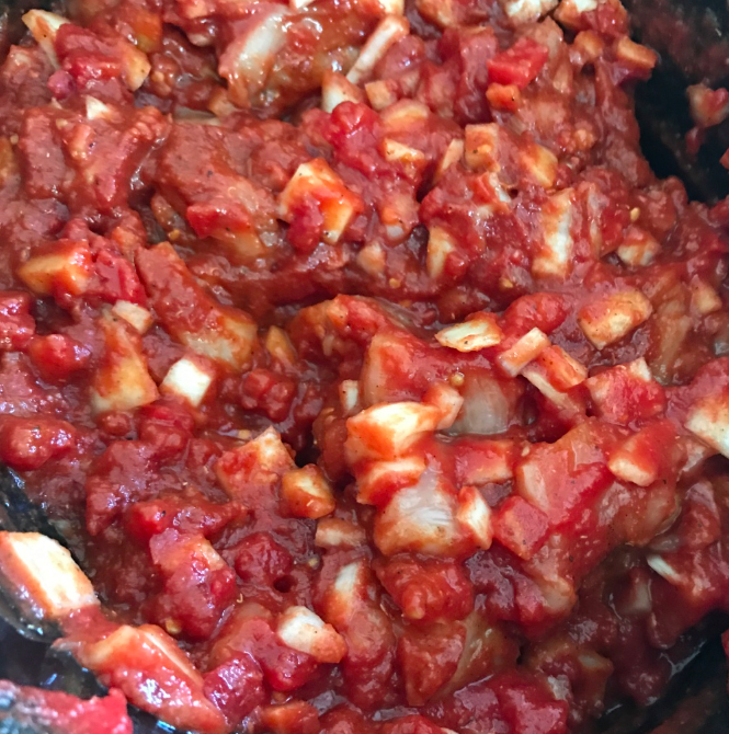 The tomato paste and sauce and mix around.