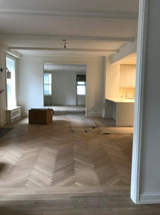 This is our future dining room and living room. I love the new floors (they are the same floors just sanded down and stained light vs the original dark color).