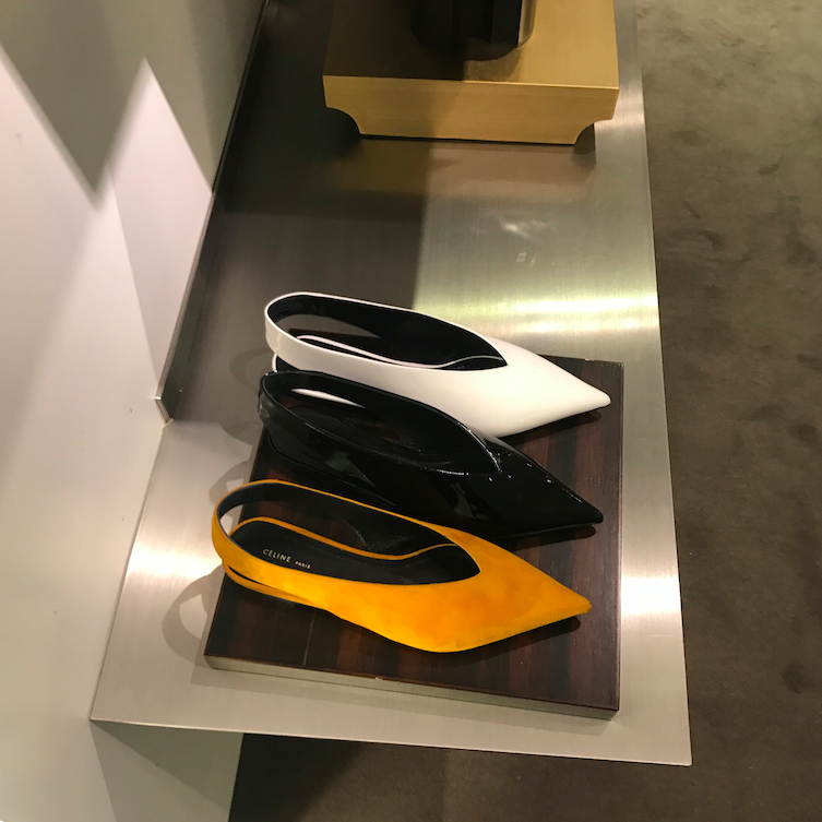 Swooning and dreaming over these yellow pointed flat shoes.