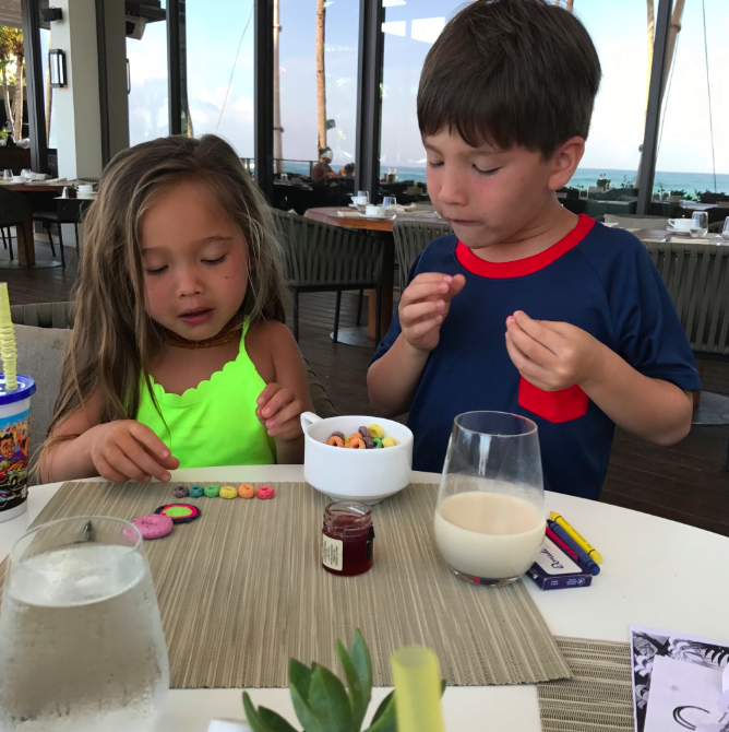 The kids are allowed Fruit Loops on vacation for dessert post breakfast. Best Mom award?