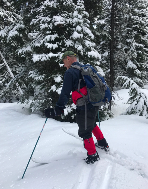 My dad in action -- this is actually one day when it snowed so much we had to blaze the trail and got lost -- his GPS made it even harder to get back on track, always an adventure with my Papa.