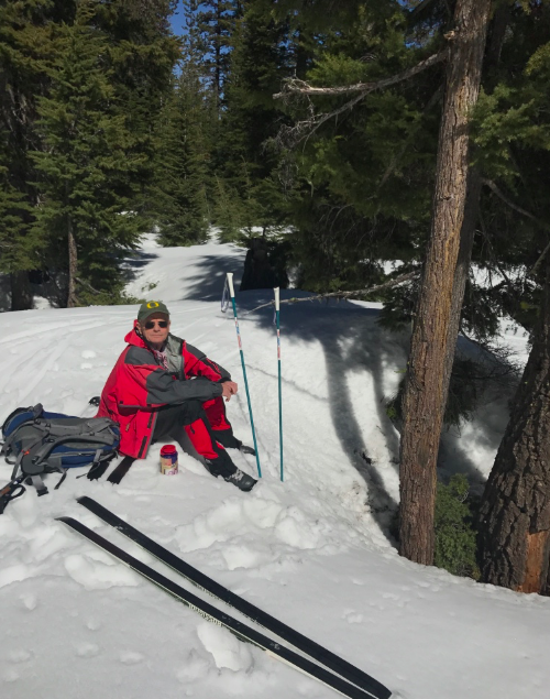 Our lunch spot -- a trick I learned from my dad is to find a tree well so you can have your feet lower, and then you put your skis backwards so you have a dry spot for your tush to sit on.