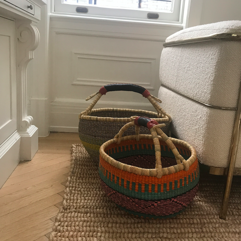 Baskets at the edge of the chair.