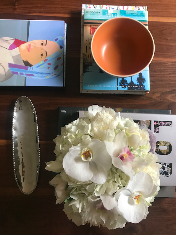 Table, coffee book, and flowers.