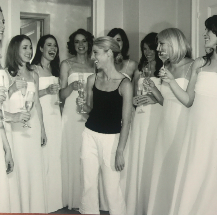 I love this behind the scene shot of me getting dressed with my bridesmaids. Toasting to the celebration!