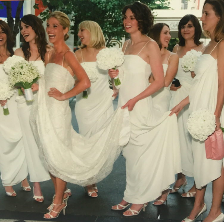The bridesmaids all got ready at The PIerre hotel. When we were waiting to go to the church, all the tourists walking by were in shock of the 10 BRIDES and all our white gowns!
