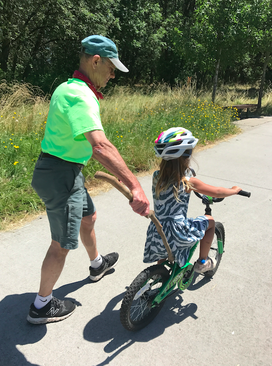 I am also in the process of (witnessing) Tusia learn how to ride a two wheel bike. My father is inspector gadget and taught Cruzzie two years ago, so now we are doing boot camp every day for her to learn -- she is so close after a little time doing it!