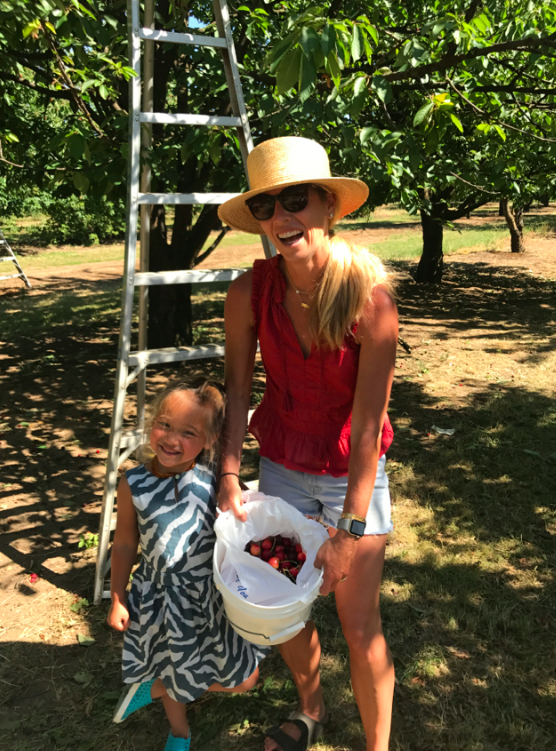 Me and my girl. And a bucket of cherries that I now have to eat before they go bad!