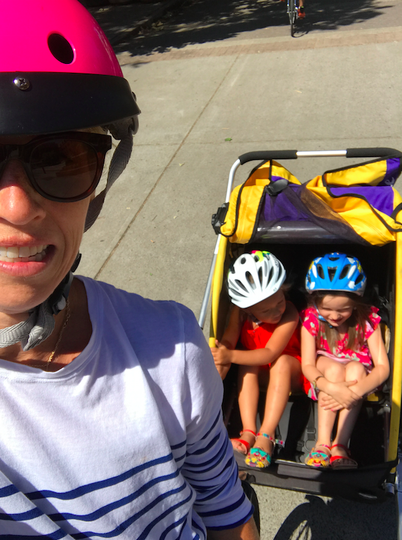 We do a lot of biking in Eugene. My parents actually don't drive anywhere, they SOLELY bike. So we have fun biking around the river, picking the kids up from camp, or just doing errands. In this photo, I am with my daughter and my littlest niece, Nadia.