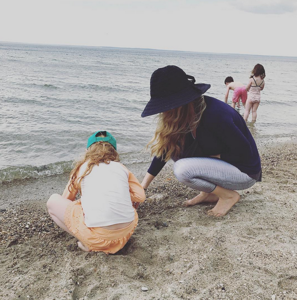 On the beach, with hats!