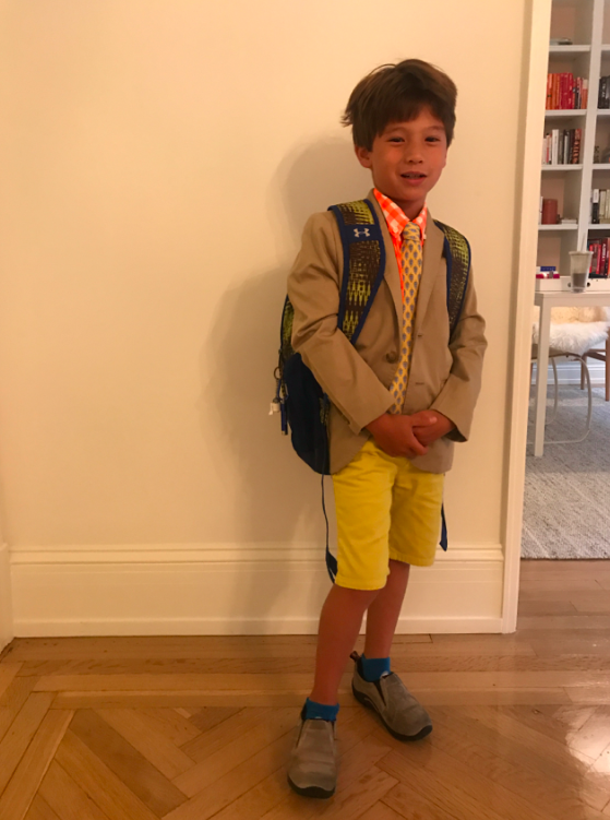 Cruzzie started 2nd grade on Wednesday. He has a uniform of coat and tie, but can wear anything. So of course, I bought him a NEON orange shirt, bright shorts, and a fun tie. Why not make a uniform full of pizazz and color?