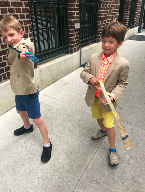 This week, the boys do not have sports like they usually do, so they were dismissed in their school clothes. Of course, two minutes later (or really, two seconds later), ties off, shirts off, blazers off. Here is Cruzzie with his best friend, his soul brother, Henry.